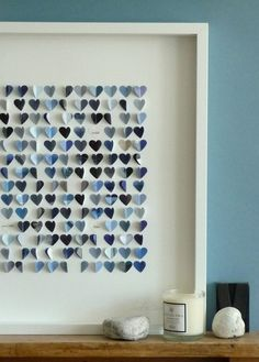 Cute shapes out of different color paint chips. Voila! A new piece of art for that empty wall space!