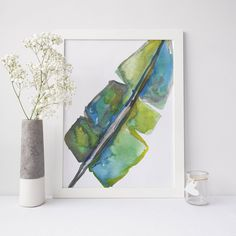 Add style to any gallery wall with this palm leaf print. It was painted by hand with bright green and yellow watercolors.