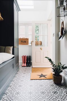 Pink Ground Painted Back Door - Utility And Boot Room With Down Pipe Painted Custom Tiles And Patterned Tile Floor. Boot Room Utility, Utility Cupboard, Hall Flooring, Entryway Flooring, Diy Flooring, Tiled Hallway, Entry Tile, Painting Tile Floors, Tiled Floors