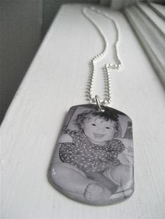 Another option for a new photo necklace. Dog tag-look. Would have to buy 3 separate ones and either combine or wear them together. $27.50 each.