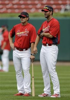 Adam Wainwright talks with manager Mike Matheny during a workout on 10-02-13..the day before game 1 of the NLDS