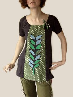 I am really proud of the collaboration going on between Mary and Chris of MaryInk and me.  Here is the first piece and the one I really like.   Front panel is recycled silk. Screenprinted design has been cut out and applique. Silk ribbon and wood beads.  :)