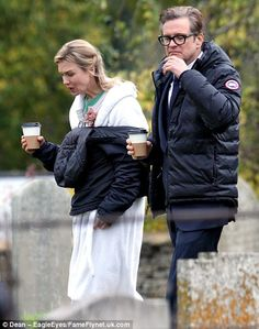 Time to rehydrate: Renee and Colin wrapped up warm and carried hot beverages across the ch...
