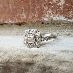 Antique Engagement Ring ,Edwardian Old Cushion Cut Diamond Halo Engagement Ring in Platinum by CypressCreekVintage on Etsy https://www.etsy.com/listing/486251652/antique-engagement-ring-edwardian-old