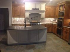 After of 001. Customer wanted an updated version. New island and hood range with back splash