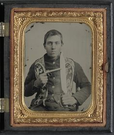 LOC #32618 - Unidentified soldier in Confederate uniform with single shot percussion pistol and D guard Bowie knife