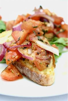 Ingredients: 1 Baguette French bread; cut into 1-inch slices about 20 pieces 1 cup diced plum tomatoes 2 green onions; chopped, 4 oz feta cheese; crumbled 1 small red onion diced fresh or pan saute…