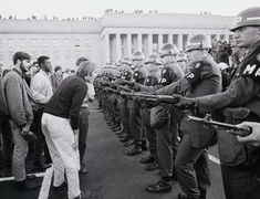 Anti-war demonstrators confront troops in Washington D., Looking back, the Vietnam buildup was just beginning. Vietnam Protests, Vietnam War, Sweat Lodge, Vietnam History, In Cold Blood, 50 Years Ago, Military Police, Military Clothing, Recent Events