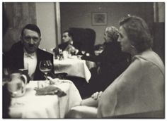 Adolf Hitler and Eva Braun at an elegant dinner