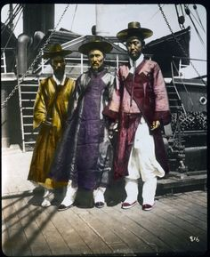 Three Korean Gentlemen posed on deck of ship, hand-colored. William Henry Jackson (1843-1942), photographer. Library of Congress