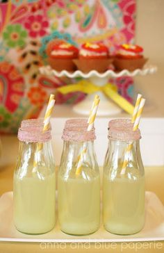 Starbuck's Frappuccino bottles to serve fresh lemonade in.   I dipped the bottles in pink sugar sprinkles and placed yellow striped straws from Shop Sweet Lulu to top off the look