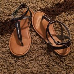 American eagle black and pink sandals American eagle black and pink sandals.  Still in very good used condition! Super comfy! You can see in the third picture where a piece of the leather is starting to wear.  Otherwise super cute sandals! American Eagle Outfitters Shoes Sandals