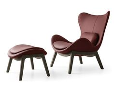 Leather armchair and stool | red leather chair |www.bocadolobo.com/ #modernchairs #luxuryfurniture #chairsideas
