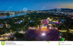 BUDAPEST, HUNGARY -Aerial panoramic photograph of Sziget Festival and main stage with the skyline of Budapest at background at blue hour. Sziget Festival is the biggest music festival in Europe Big Music, Blue Hour, August 12, Music Festivals, Budapest Hungary, Maine, Stage, Editorial, Fair Grounds