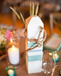 Hand-painted buoys add a seaside touch to this tablescape
