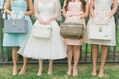bridesmaids holding suitcases: could be extra cute for a destination wedding!