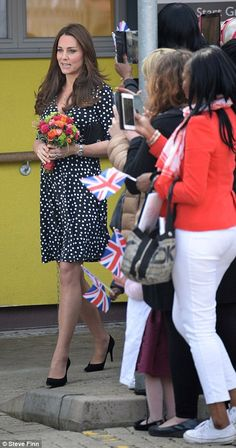 Pleased: The Duchess looked thrilled with her warm reception and chatted to volunteers about the imminent birth of her second child
