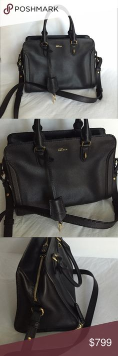 """Alexander McQueen SMALL PADLOCK ZIP AROUND Black SMALL PADLOCK ZIP AROUND Grainy calf leather soft-sided top-handle bag embossed with Alexander McQueen logo; features additional long shoulder strap, detachable chunky skull padlock and leather encased keys. The bag is cotton lined and has an interior zip pocket and double zip closure. Brass hardware with gold finish ‼️ Notice that this bag is missing the skull padlock. (Which reflects the price). NWOT    9""""H x 11.5""""W x 7""""D; bag weight…"""