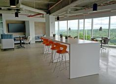 Ibis chairs in Orange with polymer seats on high steel base. Private Office, Interior, Design, Hospitality.