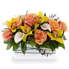 Golden - Roses, calla lilies, and cymbidium orchids - oozing with elegance arranged in a ceramic vase.