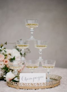 Mini champagne tower for a fancy party (on a budget)! Cocktails Vin, Cheers, Vintage Champagne Glasses, Champagne Tower, Mini Champagne, Champagne Fountain, Wedding Champagne, Our Wedding, Dream Wedding