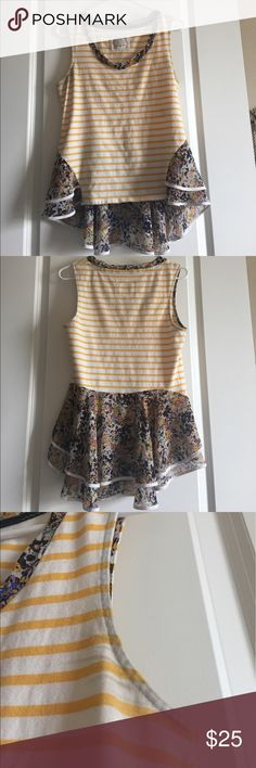 Anthro peplum top Really great top with combination of stripes and florals. In great condition- The only two imperfections are that the under arm fabric is ever so slightly darker than the body, and there is a minuscule black spot on one of the white stripes. Anthropologie Tops Blouses