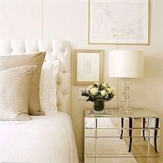 Mirrored nightstand, tufted headboard, whites and neutrals...love it! :)