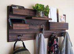 An elaborate handmade coat rack organizer.