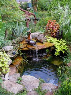 "water feature has a ""fall rock"" set atop some other rocks to create a cave; like cupping your hands to holler a long distance, this amplifies & aims the sound of the falling water towards a sitting area  --  easy water gardens"