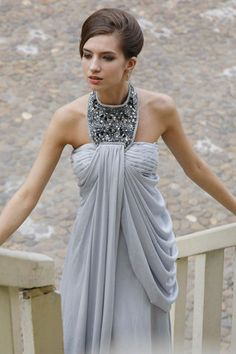 Halter neck silver wedding dress with ruched details.