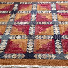 Love this quilt, pieced by Theresa W.  neat use of a log cabin block!