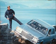 "Bond shoves Locque's car over the cliff in ""For Your Eyes Only."""