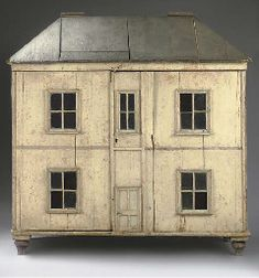 A large carpenter-built dolls' house painted to simulate stonework, with slate roof
