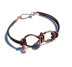 Handmade copper wire and leather bracelet by Tracy Statler Http://makebraceletsblog.com