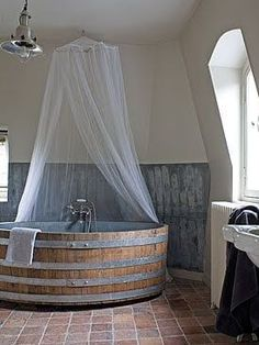 xlarge wooden barrel (tub) with none other than tin backsplash and mosquito netting ~ this just makes me smile. love it! :)