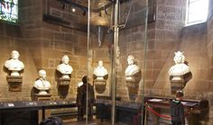 Wallace Monument, second floor gallery, The Hall of Heroes. The centerpiece on this floor is the Wallace sword...presented on stone quarried from the Abbey Craig...the sword measures 5ft 4ins, and weighs approximately 6.5lbs. The sword is surrounded by 15 white marble busts and one bronze in the Hall of Heroes. Wallace Monument, Stirling, Stirlingshire, Scotland.