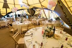 Sami Tipi wedding with round tables seating 8 per table