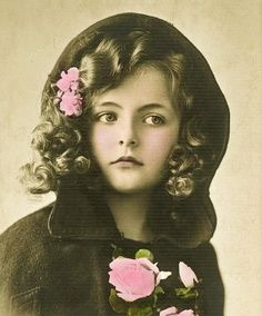 Vintage girl in cape with flowers, antique photo Christmas postcard image.