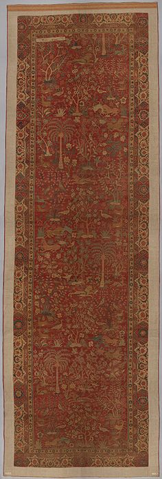 Carpet with palm trees, ibexes, and birds, Mughal period (1526–1858), late 16th–early 17th century  Present–day Pakistan, Lahore  Cotton (warp and weft), wool (pile); asymmetrically knotted pile; L. 328 in. (833.1 cm), W. 108 in. (274.3 cm)
