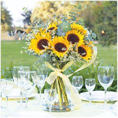 """#dawninvitecontest Sunflowers mean """"pride, adoration, loyalty devotion and faithfulness"""". So glad we picked then for our flowers :D btw-this is a beautiful centerpiece!!!"""