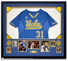 A Framed UCLA Softball Jersey with Bear Paw Cutouts in the matting, photos, plaque, and diamond cutouts in the mat corners.