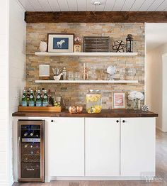 A bar built from IKEA cabinets is an entertaining staple in the newly remodeled home. Tiling t. Ikea Built In, Built In Bar, Built Ins, Wall Bar Shelf, Wall Shelves, Bar Ikea, Countertop Concrete, Armoire Ikea, Ikea Cabinets