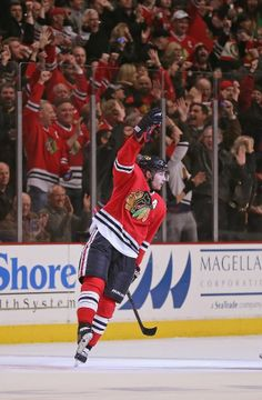 CHICAGO, IL - MARCH 19: Duncan Keith #2 of the Chicago Blackhawks celebrates his first period goal against the St. Louis Blues at the United Center on March 19, 2014 in Chicago, Illinois. (Photo by Jonathan Daniel/Getty Images)