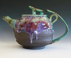 Gorgeous teapot by Kazem Arshi on etsy.  I love the vibrant drips of glaze and the contrast in texture.