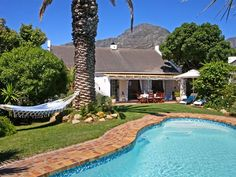 Hout Bay Beach Cottage - Set within a tranquil and private garden, Hout Bay Beach Cottage offers a relaxing getaway to small groups visiting this picturesque gem of Cape Town.  This charming cottage has three lovely bedrooms and ... #weekendgetaways #houtbay #southafrica