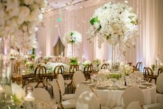 Tall White Centerpiece & Rose Gold Chairs    Photography: Samuel Lippke Studios   Read More:  http://www.insideweddings.com/weddings/romantic-jewish-wedding-with-lush-ivory-flowers-rose-gold-details/790/