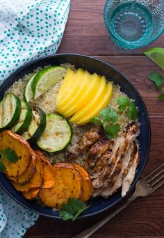 An easy recipe for Jamaican jerk chicken quinoa bowls, topped with grilled sweet potato and zucchini, mango, and a jerk salad dressing.