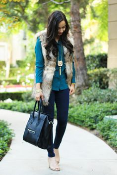 faux fur vest, booties, and statement jewelry