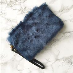 "KC Furry wristlet KC furry wristlet . Faux fur in dark regal blue. 8""x5"" lined Bags Clutches & Wristlets"