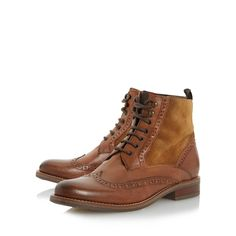 Borrow from the boys with Philomena, a mixed material lace up ankle boot. Made in Italy this brogue style features punch hole and wingtip detailing. The almond toe and inside zip fastening completes this preppy number.